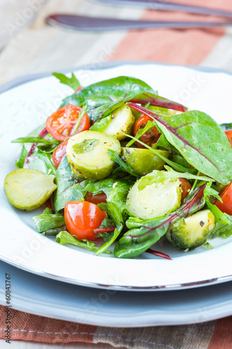 Healthy salad with brussels sprouts cabbage , tomatoes, salad