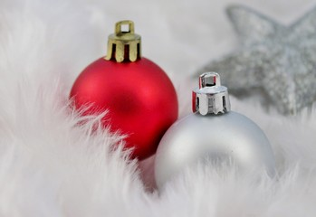 Christmas baubles balls in red and silver and fake snow