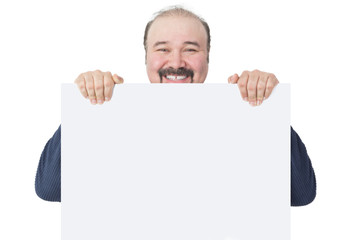 Happy mature man holding a blank billboard