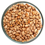 Pinto Beans Raw Unwashed in Glass Bowl Over White