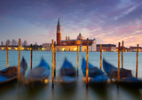 Gondolas on Saint Mark square with San Giorgio di Maggiore churc