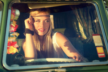 attractive blonde woman driving an old car