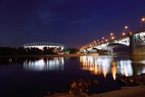 Poniatowski Bridge and National Stadium in Warsaw by night.