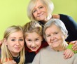 Senior woman with her granddaughters. Happy and smiling.