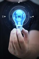 close up of man hand holding light bulb