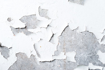 wall with peeling white paint