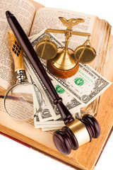magnifying glass , gavel and old law books