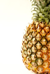 ripe juicy organic pineapple on white background
