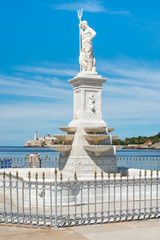 Statue of Neptune and the castle of El Morro in Havana