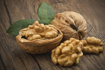 Walnuts group close up on the wooden table