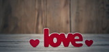 Word ''love'' on a old wood planks.