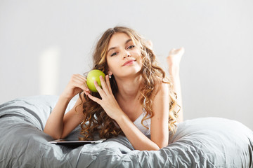 Young cute girl with apple