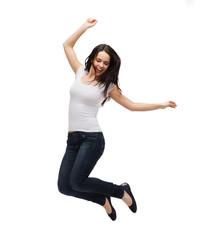 teenage girl in white blank t-shirt jumping