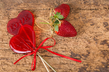 strawberries and heart shaped candies for valentine