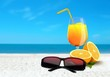 Orange Juice and Sunglasses at the Beach