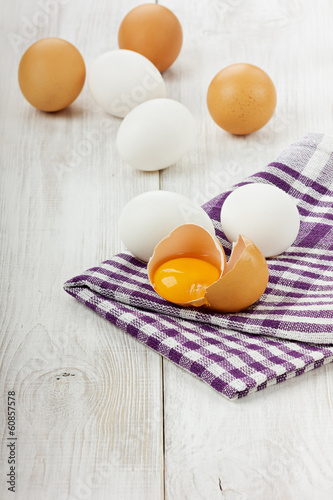 White and brown eggs on a linen napkin