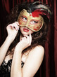 young woman in a red mysterious  mask