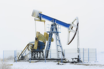 Operating oil and gas well isolated on snow white background