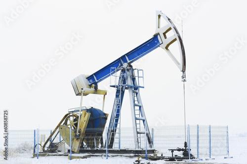 Leinwandbild Motiv Operating oil and gas well isolated on snow white background