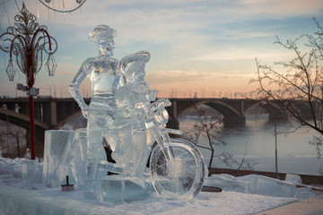 Don Quixote and it squire on a bicycle, a sculpture from ice