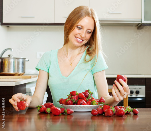 blonde long-haired girl with strawberry