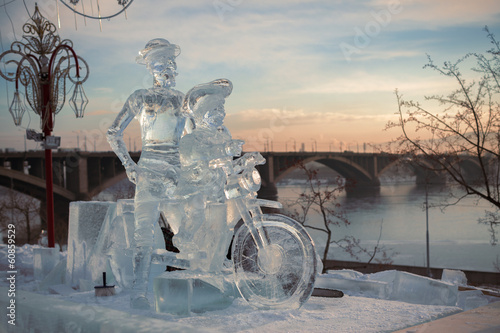 City on the water Don Quixote and it squire on a bicycle, a sculpture from ice