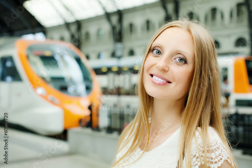 Woman waiting train at  station