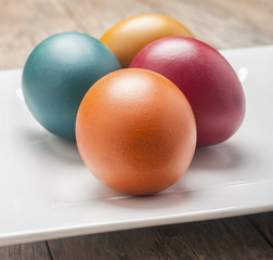 Bright and cheerful Easter still life with rainbow color eggs