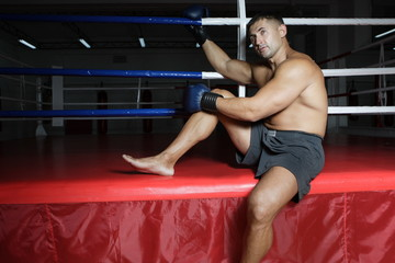 Boxer with gloves on training in the gym