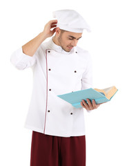 Professional chef  with book, in white uniform and hat,