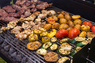 Meat and vegetable barbeque over coals