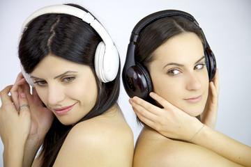 Beautiful women listening music naked