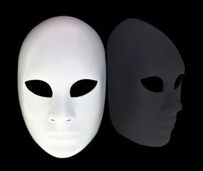White mask with reflection on black background