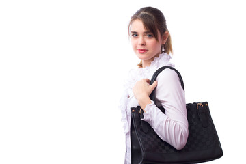 Beautiful cute young girl with a bag on her shoulder