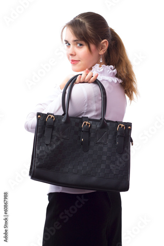Beautiful cute young girl with a bag behind the back