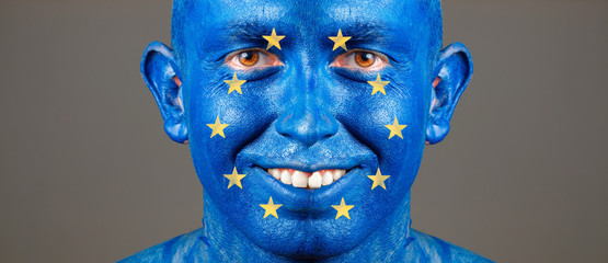 Man with his face painted with the flag of European Union
