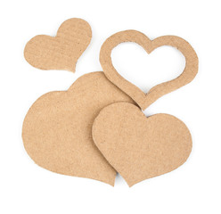 Cutout hearts  made of cardboard. Isolated on white background