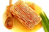 Close up delicious golden honeycomb on white background.Stock ph