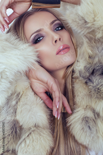 portrait of beautiful woman in fur coat