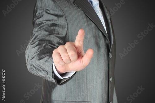 Man pushes icon on dark background