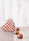 Chocolartes and decorative heart, text space