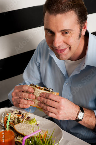 Man eating sandwich in a restaurant
