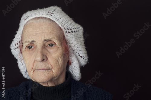 Portrait of a sad old woman