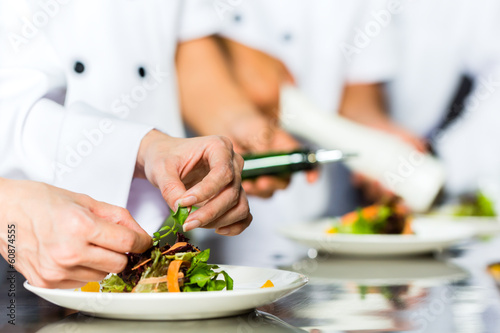 Chef in restaurant kitchen cooking - 60874555