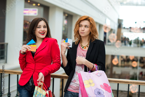Three beautiful girls with shopping