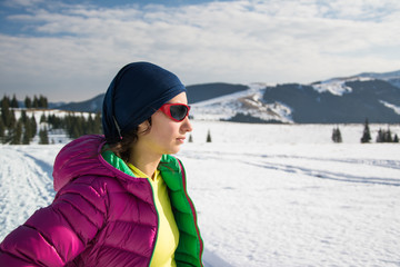 portrait of young trekker in winter