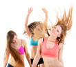 group of happy fitness teen girls have fun, dancing and jumping,