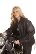Woman leather sit on motorcycle jacket look