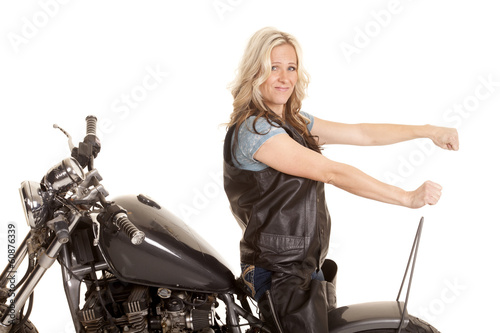 Woman leather ride motorcycle backwards
