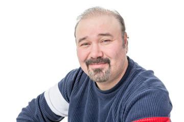 Close-up portrait of a friendly balding mature man